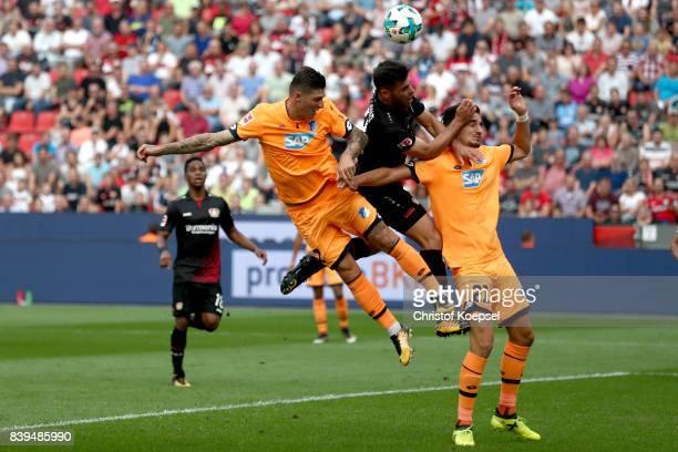 Steven Zuber of Hoffenheim and Benjamin Huebner of Hoffenheim challenge Kevin Volland of Leverkusen during the Bundesliga match between Bayer 04...