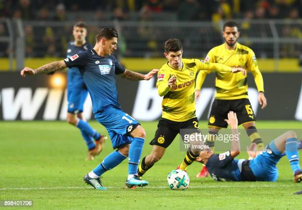 Steven Zuber of Hoffenheim and Christian Pulisic of Dortmund battle for the ball during the Bundesliga match between Borussia Dortmund and TSG 1899...