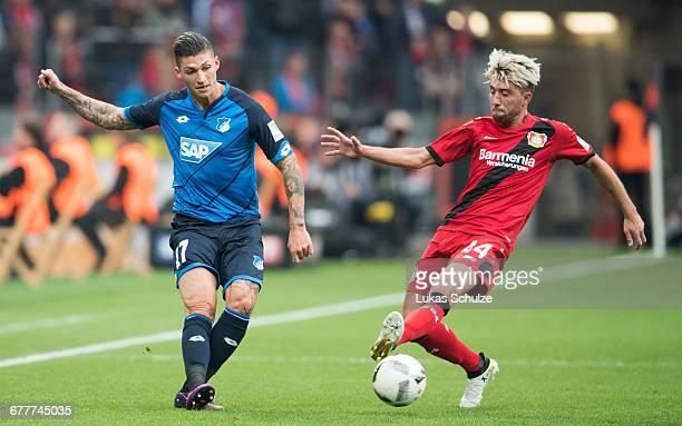 Steven Zuber of Hoffenheim and Kevin Kampl of Leverkusen in action during the Bundesliga match between Bayer 04 Leverkusen and TSG 1899 Hoffenheim at...