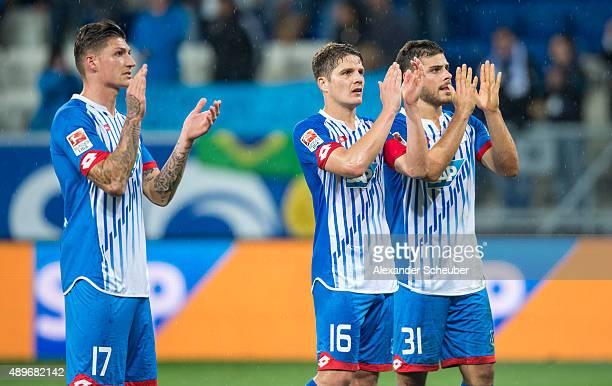 Steven Zuber of Hoffenheim Pirmin Schwegler of Hoffenheim and Kevin Volland of Hoffenheim say thank you to the fans after the bundesliga match...