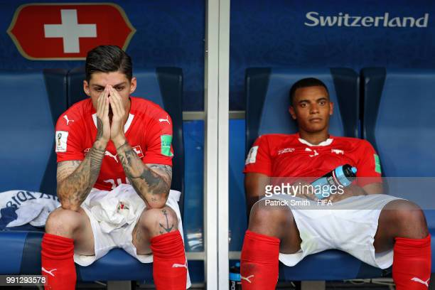 Steven Zuber of Switzerland and Manuel Akanji of Switzerland look dejected following their sides defeat in the 2018 FIFA World Cup Russia Round of 16...
