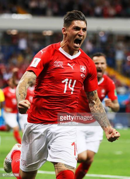 Steven Zuber of Switzerland celebrates after scoring his team's first goal during the 2018 FIFA World Cup Russia group E match between Brazil and...