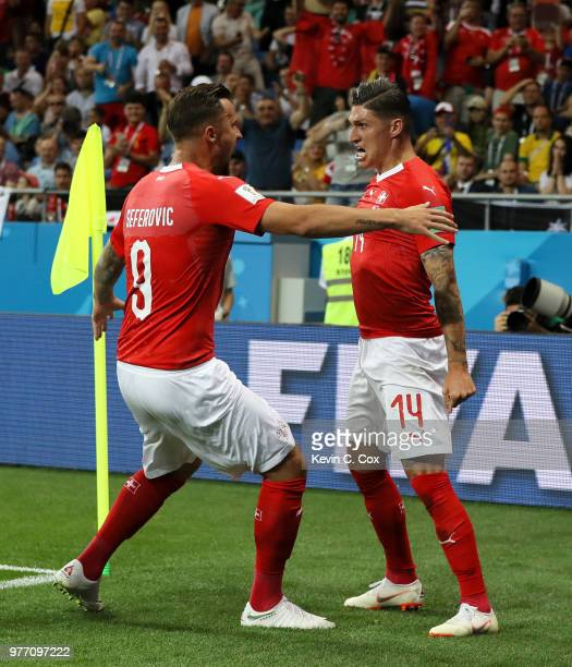 Steven Zuber of Switzerland celebrates with teammate Haris Seferovic after scoring his team's first goal during the 2018 FIFA World Cup Russia group...