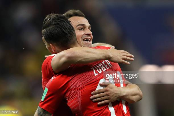 Steven Zuber of Switzerland celebrates with Xherdan Shaqiri after scoring his team's first goal during the 2018 FIFA World Cup Russia group E match...