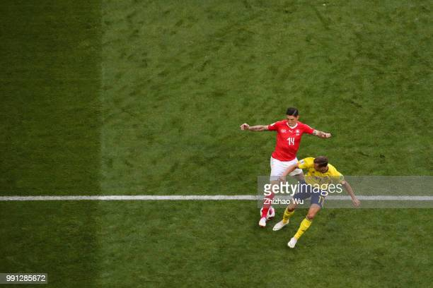 Steven Zuber of Switzerland compete with Viktor Claesson of Sweden during the 2018 FIFA World Cup Russia Round of 16 match between 1st Group F and...