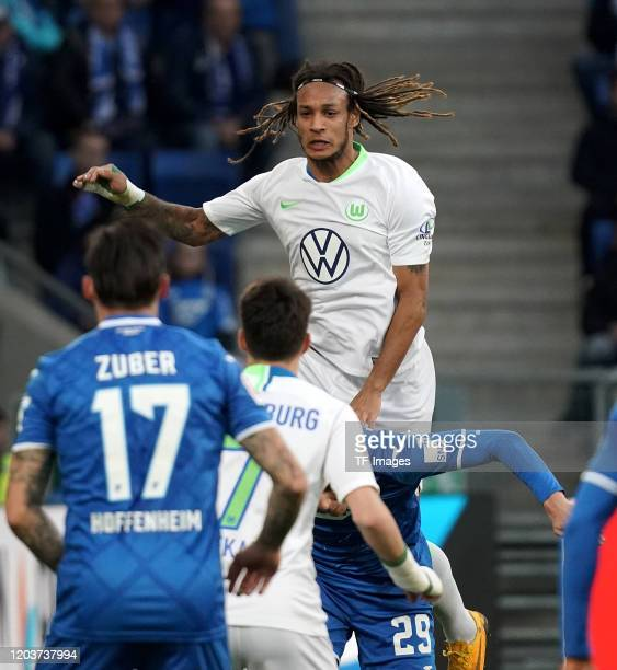 Steven Zuber of TSG 1899 Hoffenheim Josip Brekalo of VfL Wolfsburg Robert Skov of TSG 1899 Hoffenheim Kevin Mbabu of VfL Wolfsburg during the...
