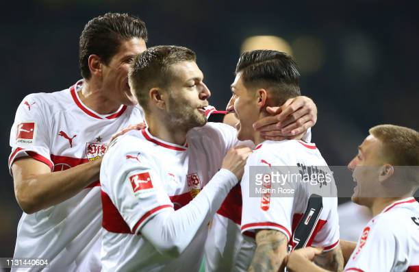 Steven Zuber of VfB Stuttgart is congratulated by team mates after scoring the opening goal during the Bundesliga match between SV Werder Bremen and...