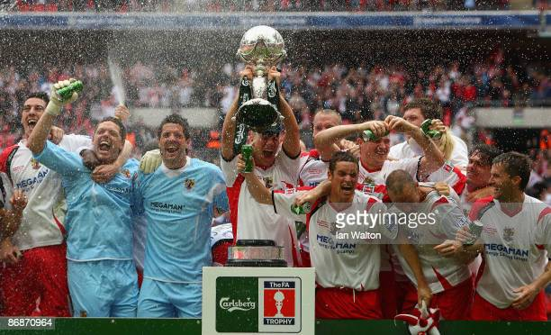 Stevenage Borough players celebrate with the trophy after winning the FA Trophy Final between Stevenage Borough and York City at Wembley Stadium on...