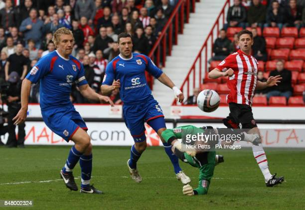 Stevenage Borough's goalkeeper Chris Day make save from Sheffield United Chris Porter's header during the npower Football League One Play Off Semi...