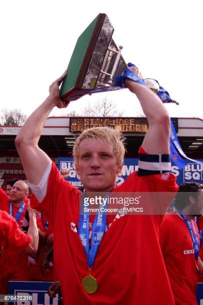 Stevenage Borough's Mark Roberts celebrates with the Blue Square North Premiership Trophy