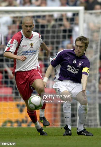 Stevenage Borough's Steve Morison and York City's Daniel Parslow battle for the ball during the FA Trophy Final at Wembley Stadium, London.