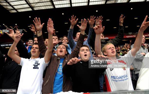 Stevenage fans celebrate after their side win during the npower League Two PlayOff Final at Old Trafford Manchester
