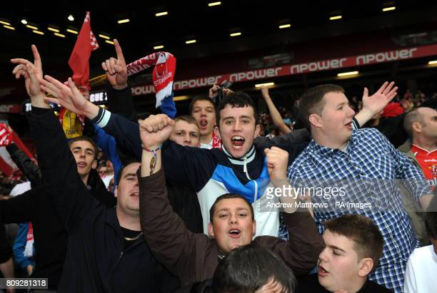 Stevenage fans celebrate in the stands after their side win the npower League Two PlayOff Final