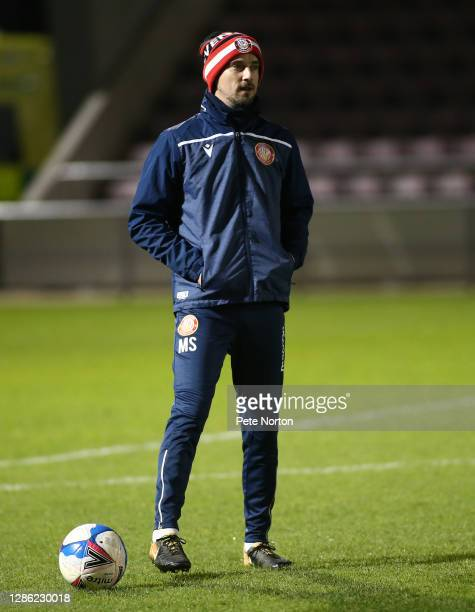 Stevenage first team coach Mark Sampson looks on during the pre match warm up prior to the Papa John's Trophy match between Northampton Town and...