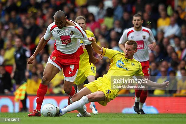 Stevenage forward Darius Charles is tackled by Chris Robertson of Torquay during the npower League Two Playoff Final between Stevenage and Torquay...