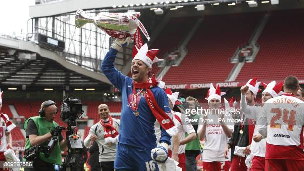 Stevenage Goalkeeper Chris Day celebrates their promotion to League One during the npower League Two PlayOff Final at Old Trafford Manchester