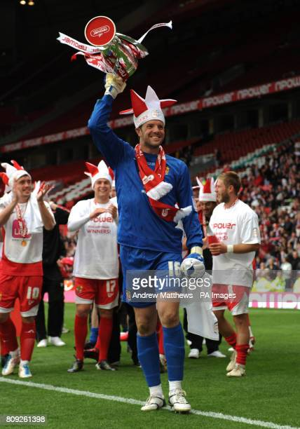 Stevenage goalkeeper Chris Day celebrates with the trophy after his side wins during the npower League Two PlayOff Final at Old Trafford Manchester