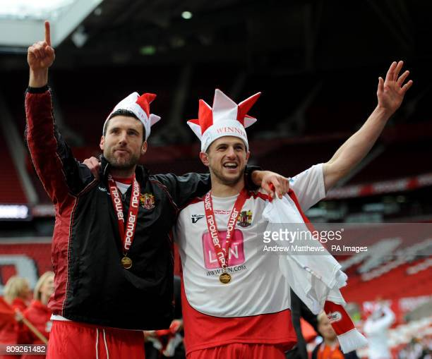 Stevenage goalscorer John Mousinho celebrates with team mate Jon Ashton after their side win during the npower League Two PlayOff Final at Old...
