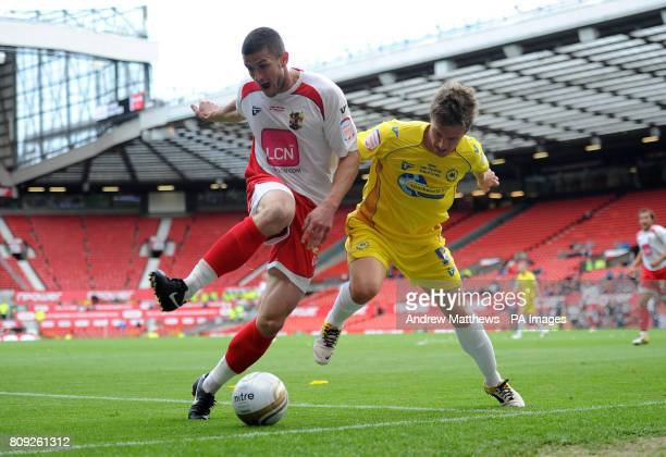 Stevenage John Mousinho and Torquay United's Jake Robinson battle for the ball during the npower League Two PlayOff Final at Old Trafford Manchester