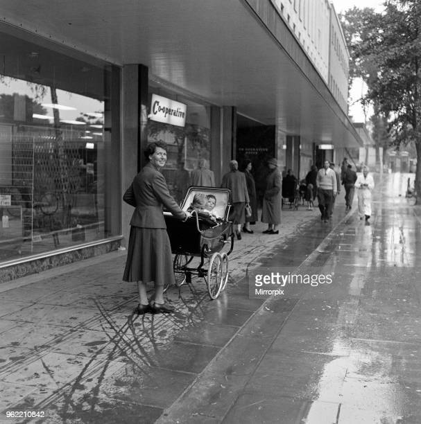 Stevenage New Town, Hertfordshire, where shoppers walk in the shelter of canopies. No cars are allowed in the area. The centre is still under...
