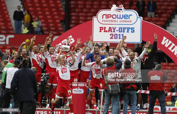 Stevenage players celebrate their promotion to League One during the npower League Two PlayOff Final at Old Trafford Manchester
