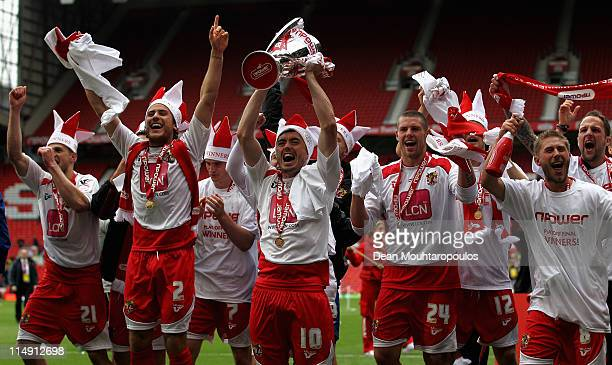 Stevenage players lead by Craig Reid celebrate with the trophy after winning the npower League Two Playoff Final between Stevenage and Torquay United...