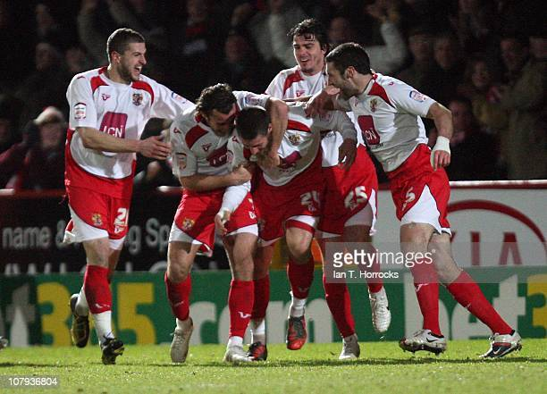 Stevenage players surround Michael Bostwick after he scored the second goal during the FA Cup sponsored by e.on 3rd round match between Stevenage and...