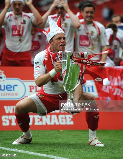 Stevenage's Chris Beardsley celebrates with the trophy after his side win during the npower League Two PlayOff Final at Old Trafford Manchester