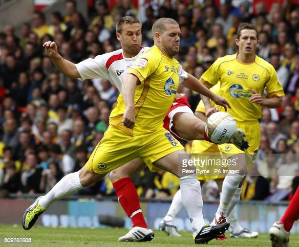 Stevenage's Joel Byrom battles for the ball with Torquay's Billy Kee during the npower League Two PlayOff Final at Old Trafford Manchester