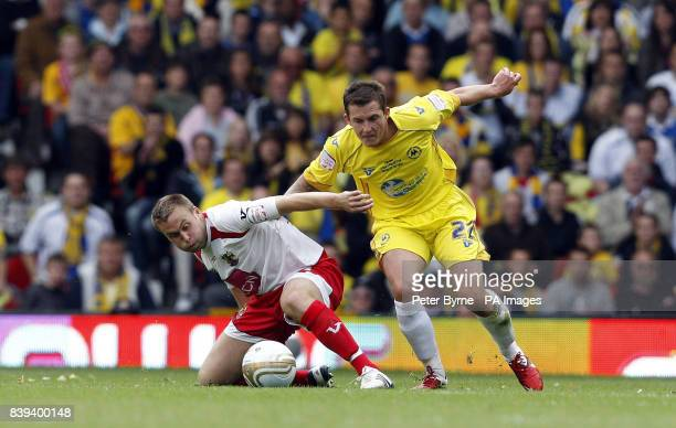 Stevenage's Joel Byrom in action with Torquay's Damon Laythrope during the npower League Two PlayOff Final at Old Trafford Manchester