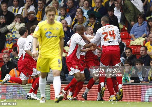 Stevenage's John Mousinho celebrates his goal with team mates during the npower League Two PlayOff Final at Old Trafford Manchester