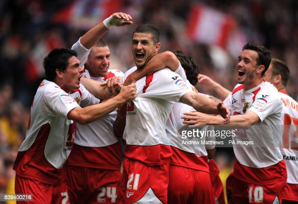 Stevenage's John Mousinho celebrates with hjs team mates after scoring the opening goal of the game during the npower League Two PlayOff Final at Old...