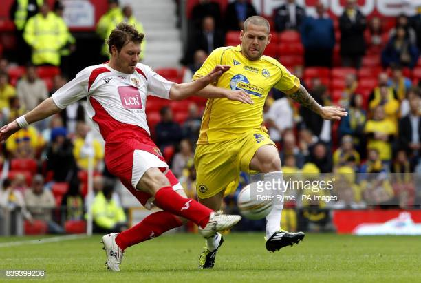 Stevenage's Scott Laird battles for the ball with Torquay's Billy Kee during the npower League Two PlayOff Final at Old Trafford Manchester