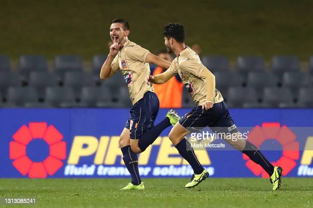 StevenUgarkovic of the Jets celebrates scoring a goal during the A-League match between Macarthur FC and the Newcastle Jets at Campbelltown Stadium,...