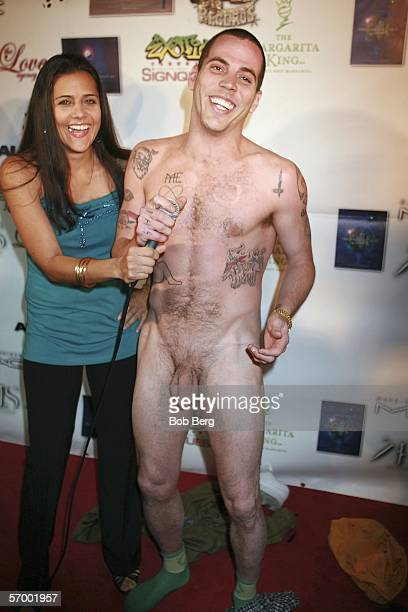 SteveO takes his clothes off as he arrives at the Masters Players Ball PreOscar Party on March 4 2006 at the Key Club in West Hollywood California