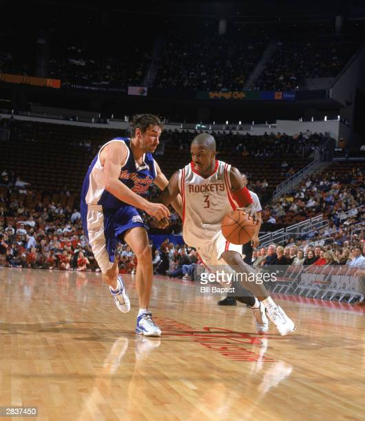 Stevie Francis of the Houston Rockets dribble drives against Marko Jaric of the Los Angeles Clippers during the game on December 19 2003 at Toyota...