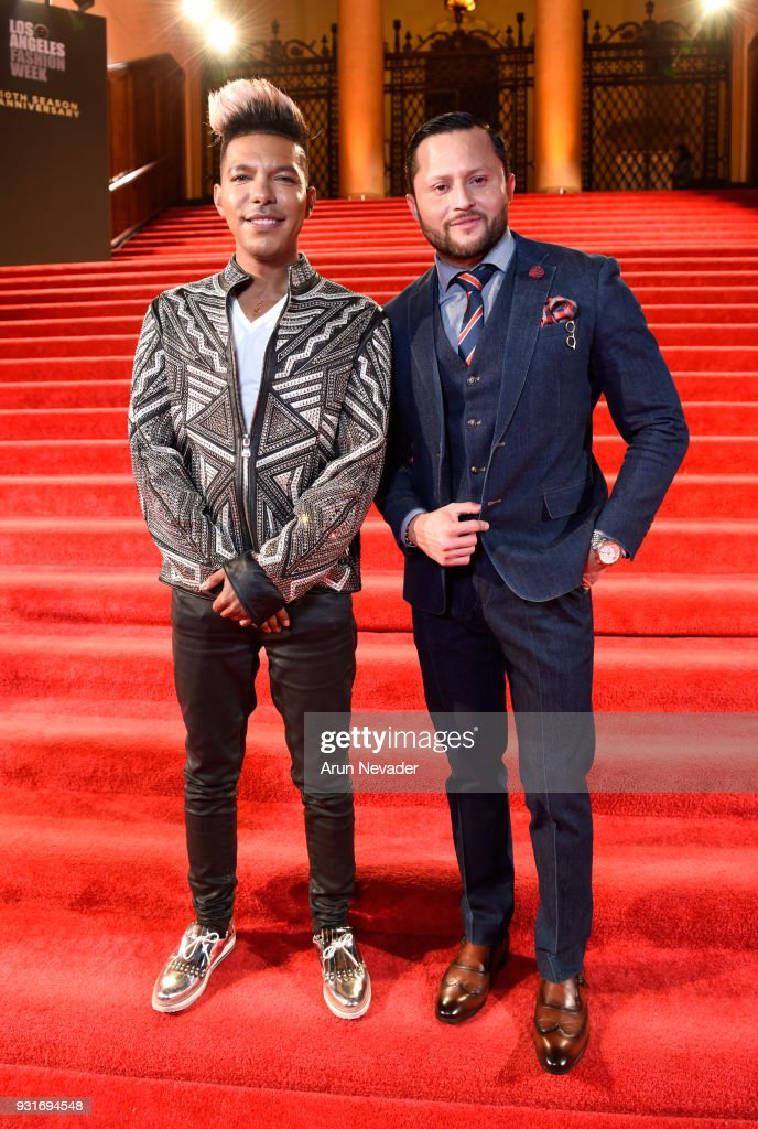Stevie Mackey (L) and Oskar Rivera at Los Angeles Fashion Week Powered by Art Hearts Fashion LAFW FW/18 10th Season Anniversary - Backstage and Front Row - Day 2 at The MacArthur on March 13, 2018 in Los Angeles, California.