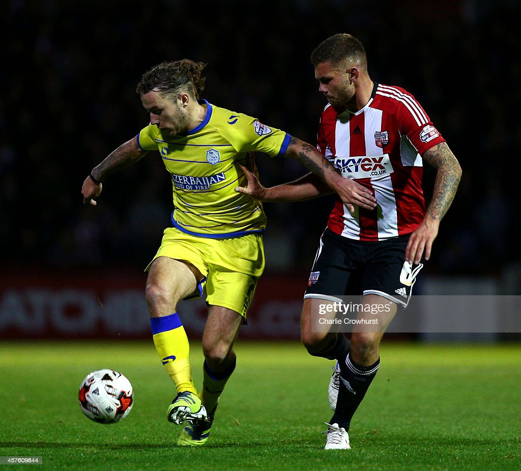Stevie May of Sheffield Wednesday holds off Brentfords Harlee Dean during the Sky Bet Championship match between Brentford and Sheffield Wednesday at Griffin Park on October 21, 2014 in Brentford, England.
