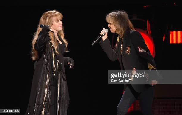 Stevie Nicks and Chrissie Hynde perform 'Stop Dragging My Heart Around' live on stage at Nassau Veterans Memorial Coliseum on April 6 2017 in...