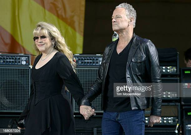 Stevie Nicks and Lindsey Buckingham of Fleetwood Mac take the stage at the 2013 New Orleans Jazz Heritage Festival at Fair Grounds Race Course on May...