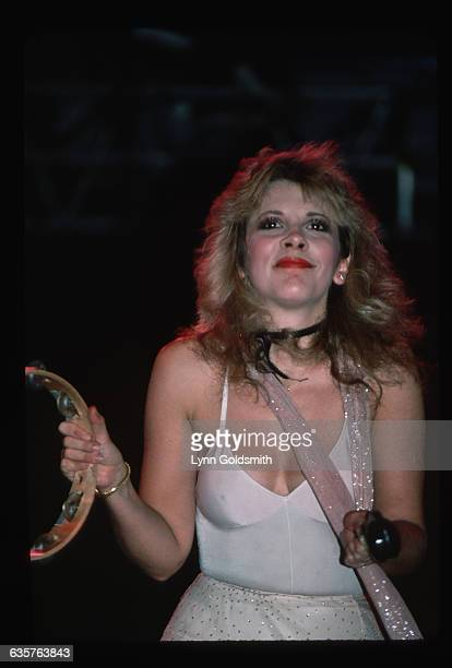 Stevie Nicks singer for the band Fleetwood Mac sings and plays the tambourine