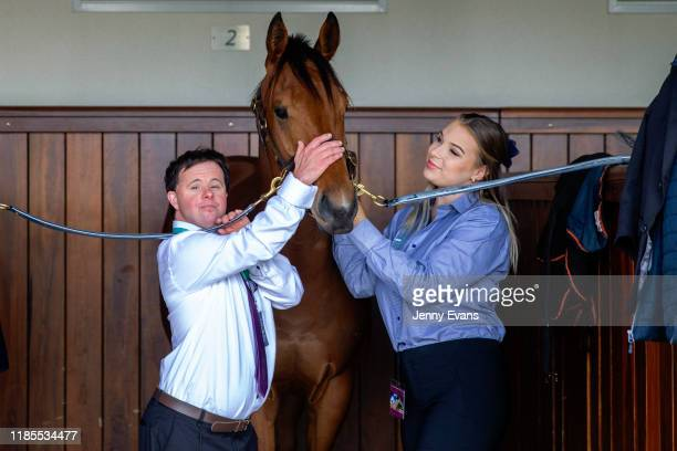 Stevie Payne brother of Melbourne Cup winning jockey Michelle Payne and strapper Ashlee Munday pose for a photo with Optimizzer during 2019 Melbourne...