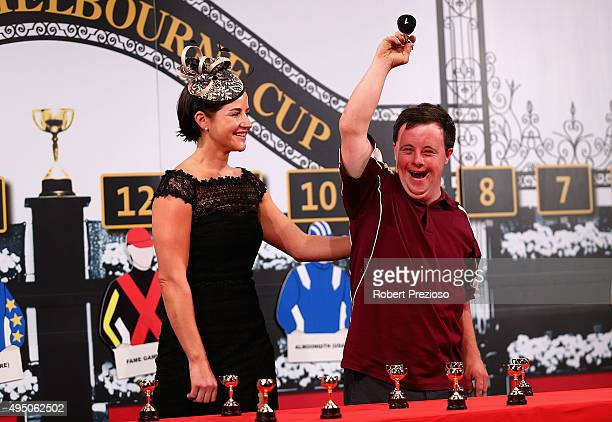 Stevie Payne reacts as Michelle Payne looks on during the 2015 Melbourne Cup Barrier Draw at Flemington Racecourse on October 31 2015 in Melbourne...