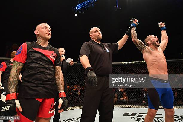 Stevie Ray of Scotland celebrates his splitdecision victory over Ross Pearson of England in their lightweight bout during the UFC Fight Night at the...