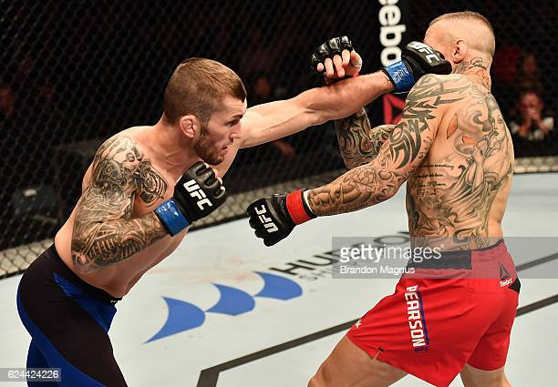 Stevie Ray of Scotland punches Ross Pearson of England in their lightweight bout during the UFC Fight Night at the SSE Arena on November 19 2016 in...