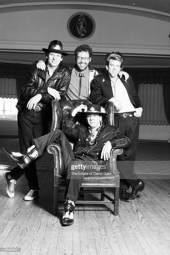 Stevie Ray Vaughan and Double Trouble (L-R Tommy Shannon, Reese Wynans, Chris 'Whipper' Layton and Stevie Ray Vaughan - seated) pose for a portrait in February, 1987 in Boston, Massachusetts.
