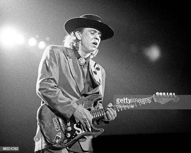 Stevie Ray Vaughan performing at the Greek Theater in Berkeley CA on October 11 1985 He plays a Fender Stratocaster guitar