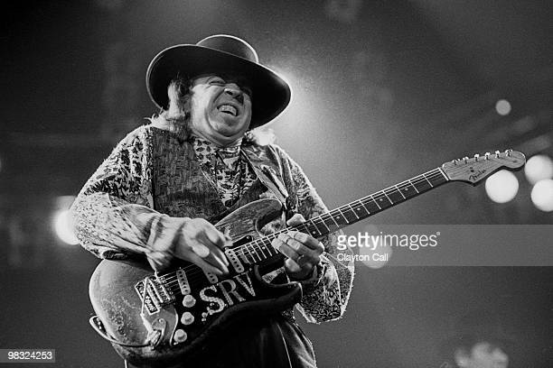 Stevie Ray Vaughan performing at the Oakland Coliseum Arena on December 3, 1989. He plays a Fender Stratocaster guitar.