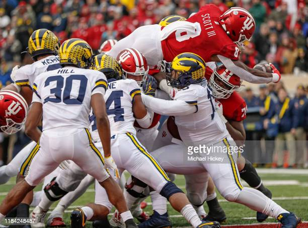 Stevie Scott III of the Indiana Hoosiers reaches over the goal line for a touchdown during the first half against the Michigan Wolverines at Memorial...