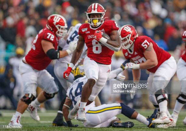 Stevie Scott III of the Indiana Hoosiers runs the ball during the first half against the Michigan Wolverines at Memorial Stadium on November 23, 2019...